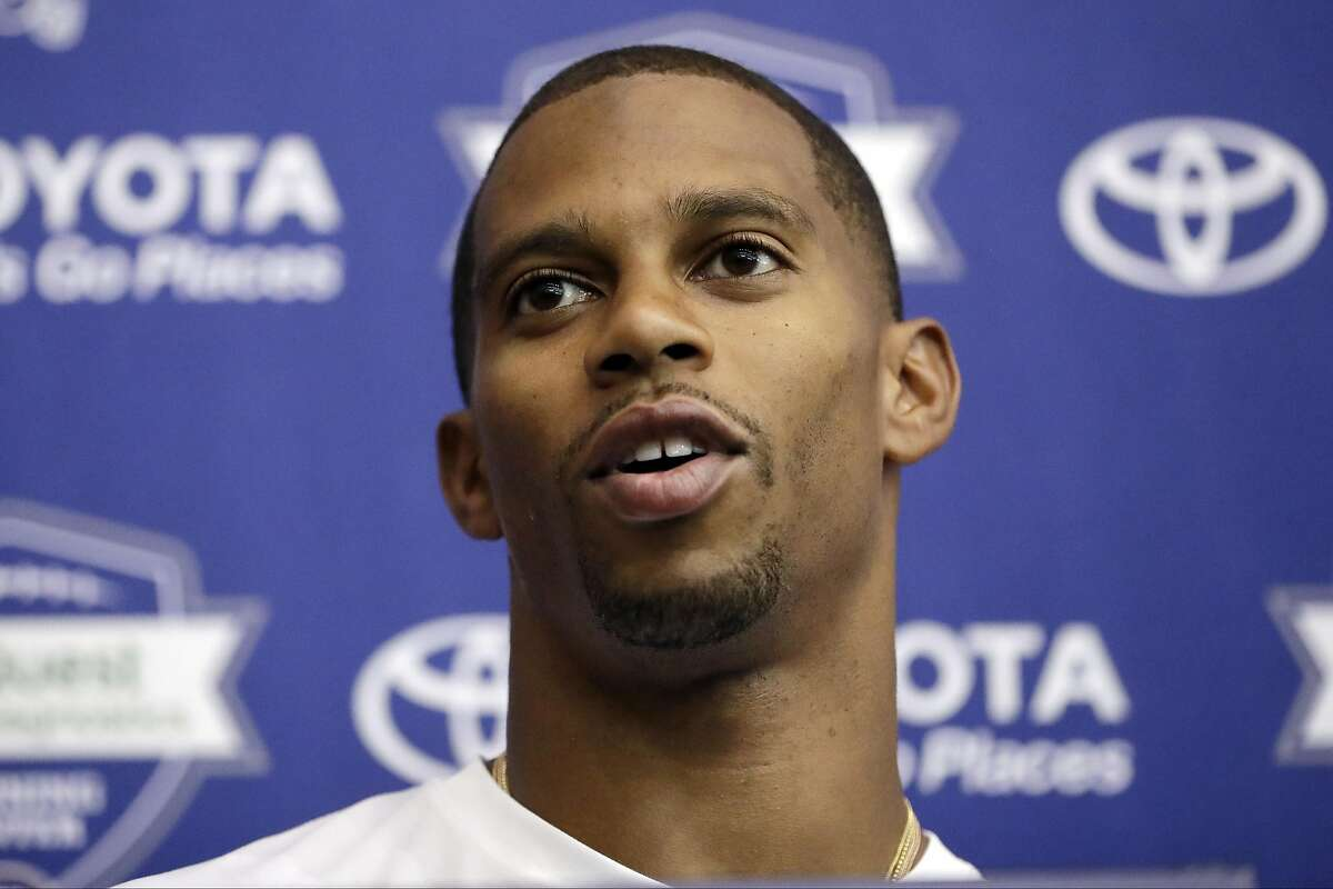 FILE - In this July 29, 2016, file photo, New York Giants wide receiver Victor Cruz talks to reporters during NFL football training camp in East Rutherford, N.J. The oft-injured Cruz isn't giving up on his hope to play for the Giants. The 29-year-old wide receiver remained optimistic Wednesday, Aug. 17, 2016, despite being sidelined the past few days by a groin injury. (AP Photo/Julio Cortez, File)