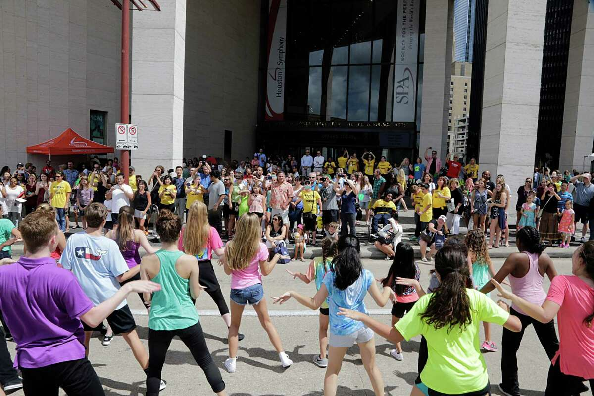 Theatre Under The Stars (TUTS) and the Humphreys School of Musical Theatre (HSMT) perform in the street outside Jones Hall during the Theater District Open House Aug. 28, 2016, in Houston.