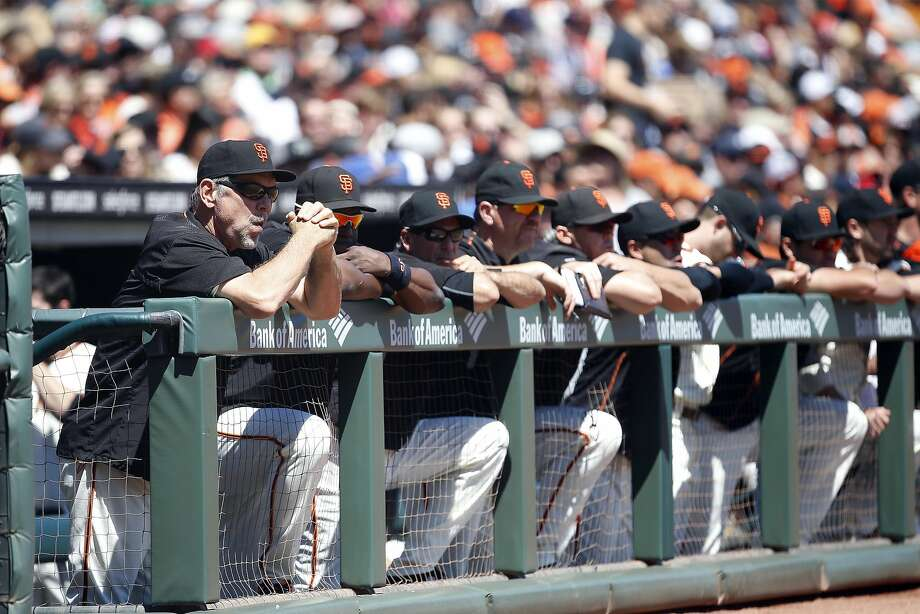 San Francisco Giants manager Bruce Bochy, left, watches the game  against the Atlanta Braves from the dugout during the first inning at AT&T Park on Sunday, August 28, 2016, in San Francisco, California. Photo: Tony Avelar, Special To The Chronicle