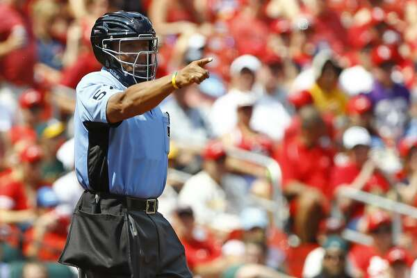 Home plate umpire CB Bucknor is seen during a baseball game between the St. Louis Cardinals and the Oakland Athletics, Sunday, Aug. 28, 2016, in St. Louis. The Athletics won 7-4. (AP Photo/Billy Hurst)