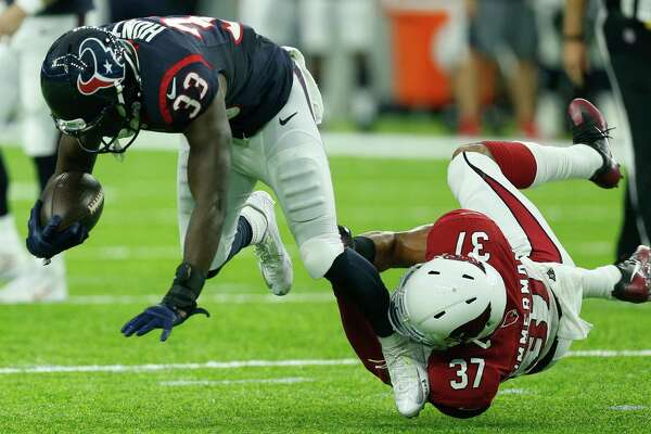 Houston Texans running back Akeem Hunt (33) is tripped up by Arizona Cardinals free safety Durell Eskridge (37) during the fourth quarter of an NFL pre-season football game at NRG Stadium on Sunday, Aug. 28, 2016, in Houston.