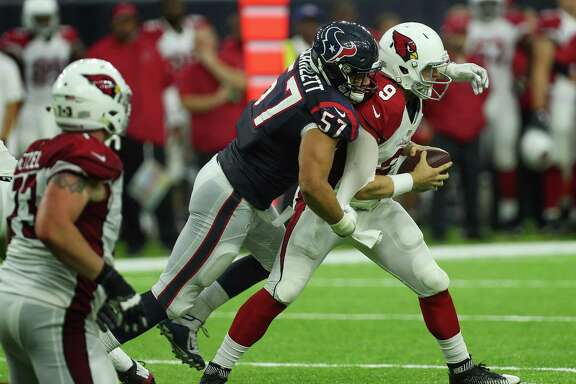 Houston Texans linebacker Brennan Scarlett (57) sacks Arizona Cardinals quarterback Matt Barkley (9) during the fourth quarter off an NFL pre-season football game at NRG Stadium on Sunday, Aug. 28, 2016, in Houston.