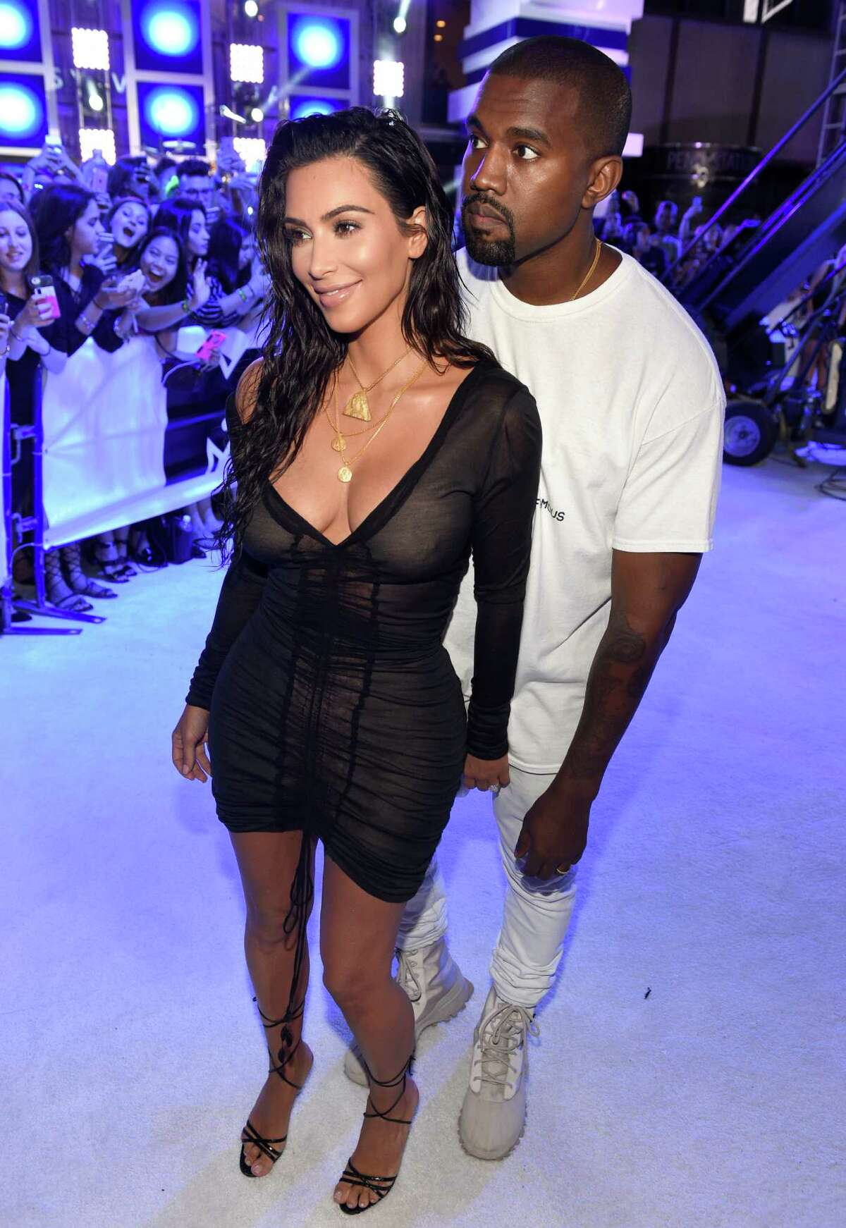 Kim Kardashian West , left, and Kanye West arrive at the MTV Video Music Awards at Madison Square Garden on Sunday, Aug. 28, 2016, in New York. (Photo by Chris Pizzello/Invision/AP)