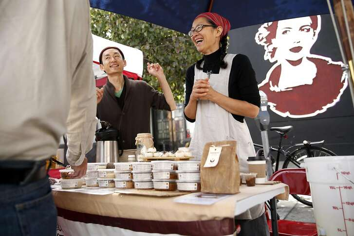 Satee Fujimoto and Mariko Grady laugh with a customer at Aedan Fermented Foods' booth at the Divisadero Farmers Market in San Francisco, Calif., on Sunday, August 28, 2016.