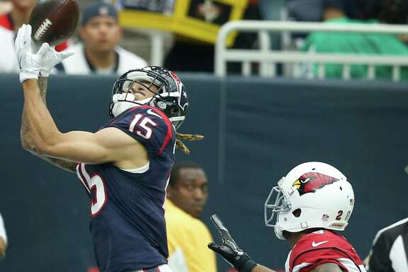 Thanks for dropping in, Texans receiver Will Fuller says to a Brock Osweiler pass that goes for a 26-yard touchdown against Cardinals cornerback Justin Bethel in the second quarter Sunday.