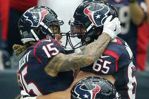 Texans receiver Will Fuller (15) celebrates his touchdown catch with center Greg Mancz (65).