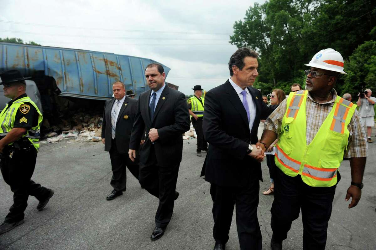 Gov. Andrew Cuomo visits the site of a train derailment on Thursday, June 27, 2013, in Mohawk, N.Y. Joe Percoco is center. (Cindy Schultz / Times Union)