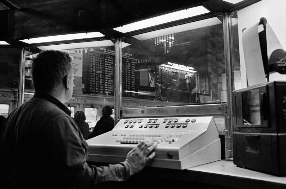 FILE -- A departures board and operator in Grand Central Terminal, in New York, Jan. 12, 1967. The departures board at Pennsylvania Station in New York, which announces Amtrak and also New Jersey Transit departures, has been deemed obsolete and will soon be demolished in favor of a system of smaller LCD screens that will be spread throughout the terminal. (Meyer Liebowitz/The New York Times) ORG XMIT: XNYT12 Photo: MEYER LIEBOWITZ / NYTNS