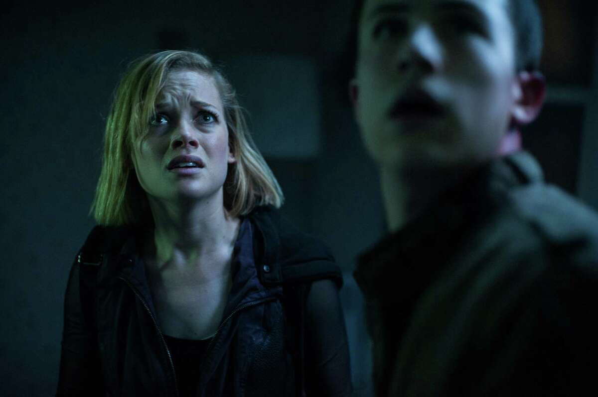 """FILE - This undated file image released by Sony Pictures shows Jane Levy, left, and Dylan Minnette in a scene from """"Dont Breathe."""" According to studio estimates Sunday, Aug. 28, 2016, audiences turned out in droves for the late summer thriller, which brought in $26.1 million. (Gordon Timpen/Sony/Screen Gems via AP, File) ORG XMIT: NY107"""