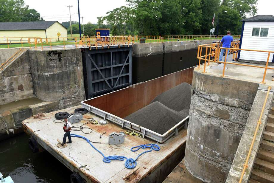 A barge carrying crushed stone from the New York State Marine Highway Transportation Company of Troy makes its way through the Champlain Canal Lock 6 on Thursday, Aug. 25, 2016, in Greenwich, N.Y. (Michael P. Farrell/Times Union) Photo: Michael P. Farrell / 20037784A