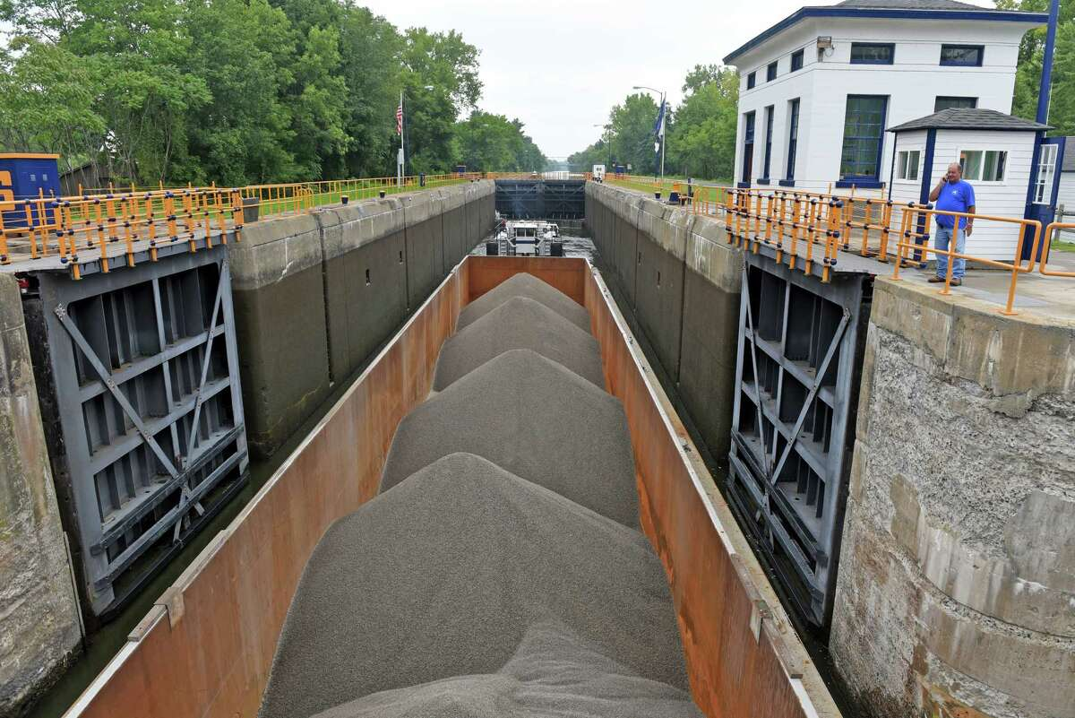 A New York State Marine Highway Transportation Company of Troy barge carrying crushed stone makes its way through the Champlain Canal Lock 6 on Thursday, Aug. 25, 2016, in Greenwich, N.Y. (Michael P. Farrell/Times Union)