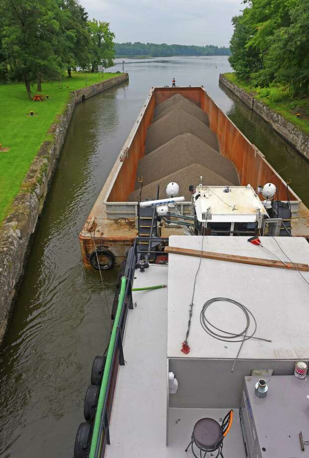 A New York State Marine Highway Transportation Company of Troy barge carrying crushed stone makes its way through the Champlain Canal Lock 6 on Thursday, Aug. 25, 2016, in Greenwich, N.Y. (Michael P. Farrell/Times Union) Photo: Michael P. Farrell / 20037784A