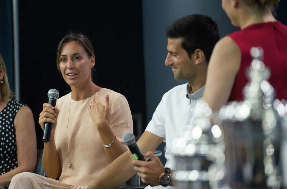 Reigning U.S. Open tennis women's singles champion Flavia Pennetta, of Italy, speaks as men's singles champion Novak Djokovic looks on during a media availability at the Billie Jean King National Tennis Center, Friday, Aug. 26, 2016,  in New York. (AP Photo/Bryan R. Smith) ORG XMIT: NYBS105 Photo: Bryan R. Smith / FR171336 AP