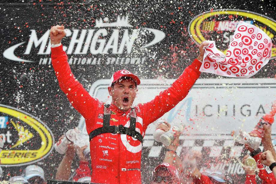 Kyle Larson celebrates after  winning the NASCAR Sprint Cup Series auto race at Michigan International Speedway in Brooklyn, Mich., Sunday, Aug. 28, 2016. (AP Photo/Paul Sancya) ORG XMIT: MIPS110 Photo: Paul Sancya / Copyright 2016 The Associated Press. All rights reserved. This m