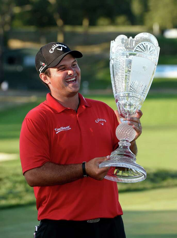 Patrick Reed smiles as he holds the The Barclays trophy after winning The Barclays golf tournament in Farmingdale, N.Y., Sunday, Aug. 28, 2016. (AP Photo/Kathy Kmonicek) ORG XMIT: NYKK125 Photo: Kathy Kmonicek / FR170189 AP