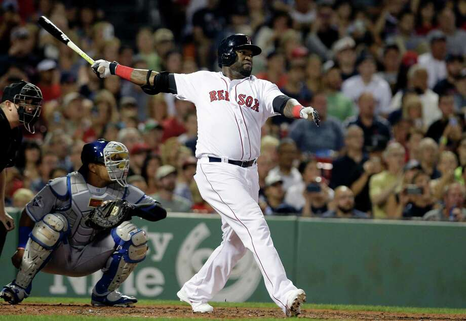 Boston Red Sox's David Ortiz, right, hits a home run as Kansas City Royals' Salvador Perez, left, looks on in the fourth inning of a baseball game, Sunday, Aug. 28, 2016, in Boston. (AP Photo/Steven Senne) ORG XMIT: MASR107 Photo: Steven Senne / Copyright 2016 The Associated Press. All rights reserved. This m