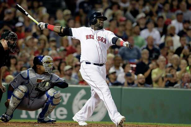 Boston Red Sox's David Ortiz, right, hits a home run as Kansas City Royals' Salvador Perez, left, looks on in the fourth inning of a baseball game, Sunday, Aug. 28, 2016, in Boston. (AP Photo/Steven Senne) ORG XMIT: MASR107