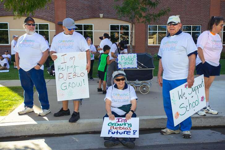 Opponents of ballot measures that would ban retail marijuana in Pueblo wait for the start of the Colorado State Fair Parade on Saturday, Aug. 27, 2016 in Pueblo, Colo.
