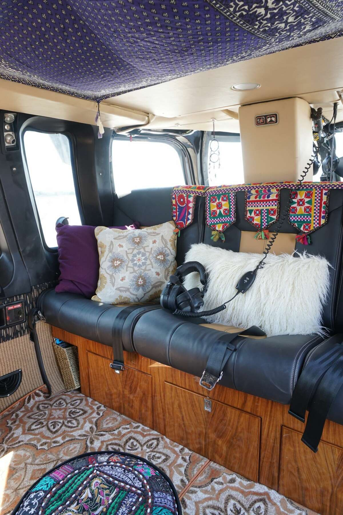 Inside the helicopter, the company has decorated the interior to give it a Burning Man vibe, complete with fuzzy pillows and rugs.