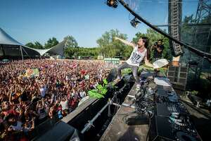 American DJ Steve Aoki throws a cream tart into the crowd during the first day of the Tomorrowland music festival, in Boom, on July 18, 2014. The 10th edition of Tomorrowland electronic music festival takes place at the 'De Schorre' terrain in Boom until July 27, 2014. AFP PHOTO / BELGA PHOTO / JONAS ROOSENSJONAS ROOSENS/AFP/Getty Images
