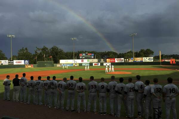 A rainbow arches the sky over Lake Olmstead Stadium during the playing of the national anthem as the single A Augusta GreenJackets play the Delmarva Shorebirds in Augusta Ga., July 15, 2016. MUST CREDIT: Washington Post photo by John McDonnell.