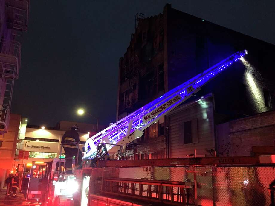 Firefighters extinguished a 2-alarm fire that ripped into a vacant brick building on Minna alley, between Fifth and Sixth streets, early Monday. Photo: Evan Sernoffsky / The Chronicle / /