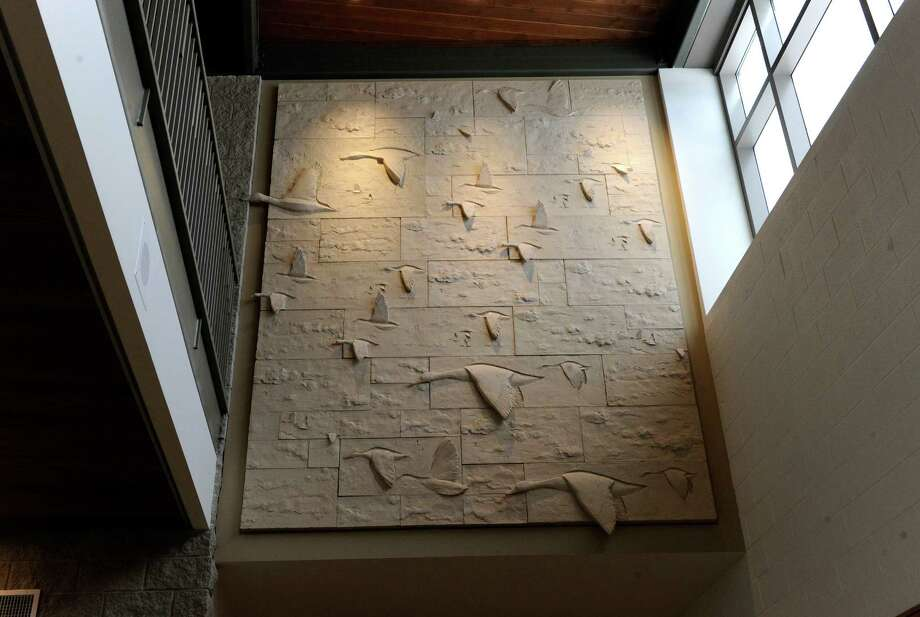 Relief sculptures of soaring flocks of ducks flank the school's cental lobby of the new Sandy Hook Elementary School. The media and the general public got their first look Friday, July 29, 2016,  at the new Sandy Hook Elementary School school built to replace the one where 20 first-graders and six educators were massacred in December 2012. Photo: Carol Kaliff / Carol Kaliff / The News-Times