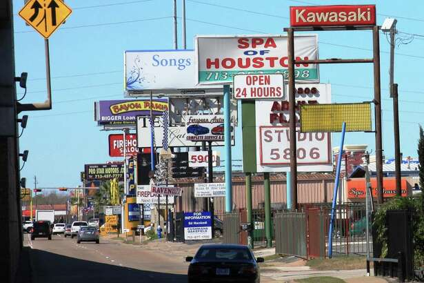 Signs along Southwest Freeway near Beltway 8. courtesy of Scenic Houston