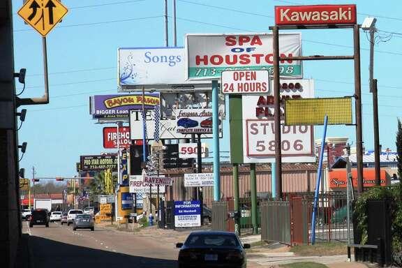 Signs along Southwest Freeway near Beltway 8. courtesy of Scenic Houston