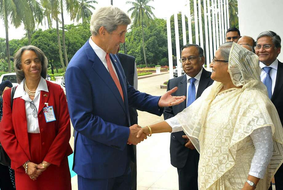 U.S. Secretary of State John Kerry and Bangladesh Prime Minister Sheikh Hasina meet ahead of their conference in the capital of Dhaka. Photo: STRINGER, AFP/Getty Images