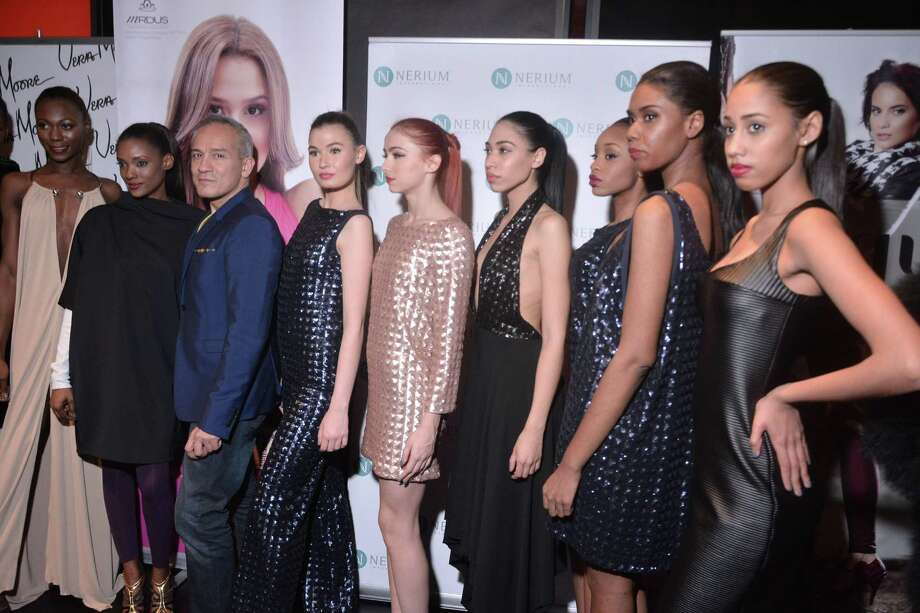 Houston-born designer and New York Fashion Week regular Cesar Galindo, third from left, strikes a pose with models after showing his fall/winter 2015 collection in New York. On July 30, 2015, Galindo will present a free fashion show highlighting that collection at the St. Anthony Hotel. Photo: Picasa, Courtesy John Caballero / San Antonio Express-News