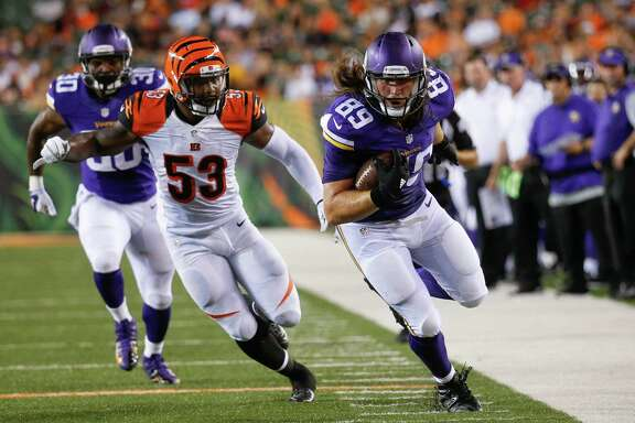 Minnesota Vikings tight end David Morgan, a former UTSA star, runs after a catch as Cincinnati Bengals outside linebacker Marquis Flowers (53) pursues during the second half of a preseason game on Aug. 12, 2016, in Cincinnati.