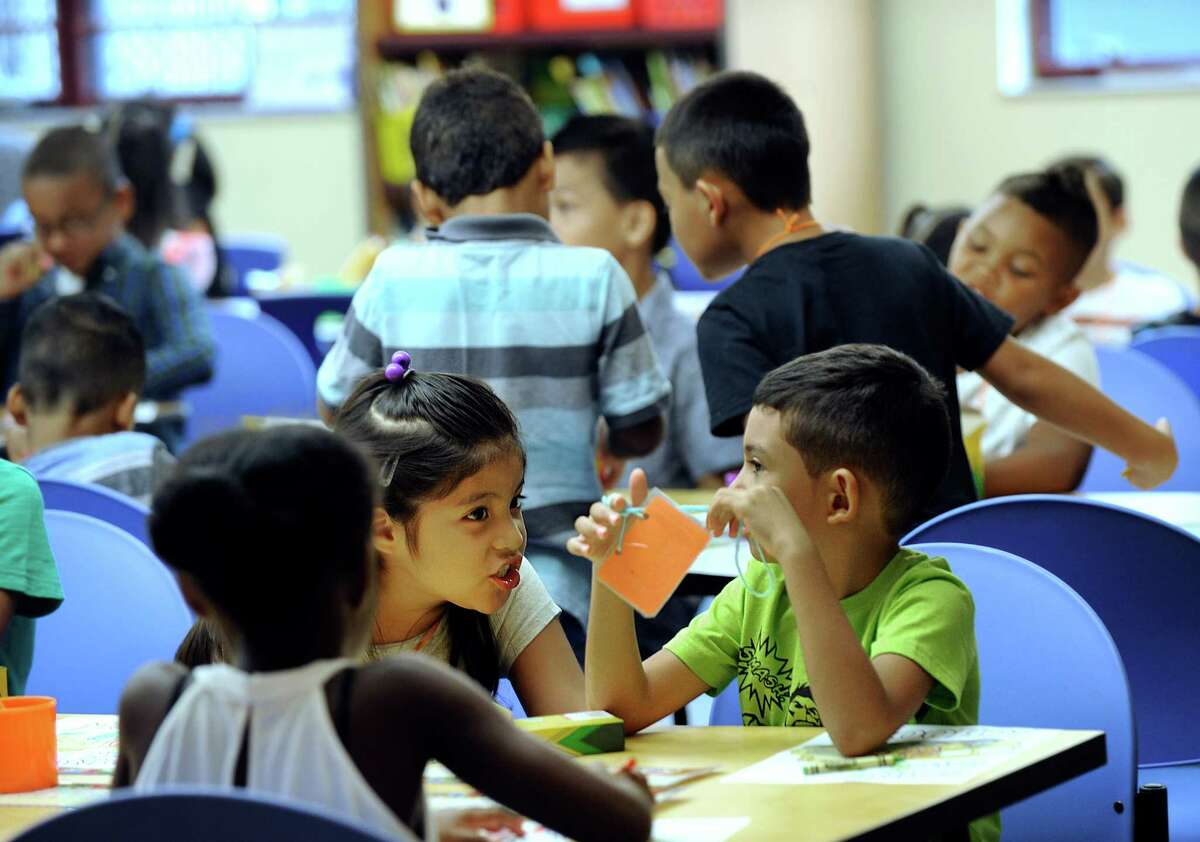 Genesis Tenesaca, left, and Dominic Cepeda, chat together in their second-grade class at Ellsworth Avenue Elementary School in Danbury on the first day of school, Monday, August 29, 2016.
