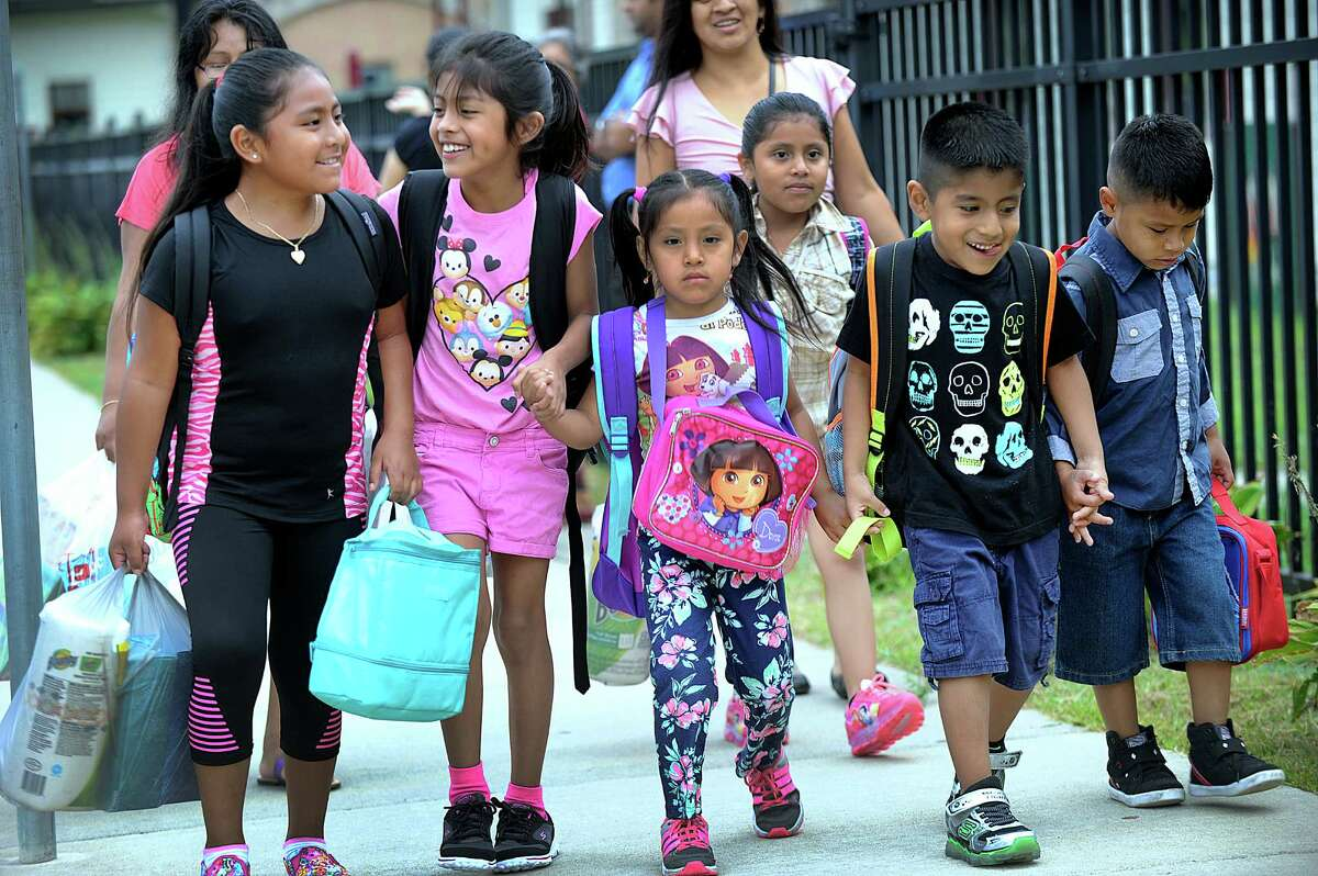 Kids arrive for the first day of school at Ellsworth Avenue School in Danbury Monday, August 29, 2016. From left are Sabrina Tapia, 9, Hailey Vizhco, 8, Joclyn Durazno, 5, Lizbeth Durazno, 7, Christopher Vizhco, 6, and Henry Durazno, 6.