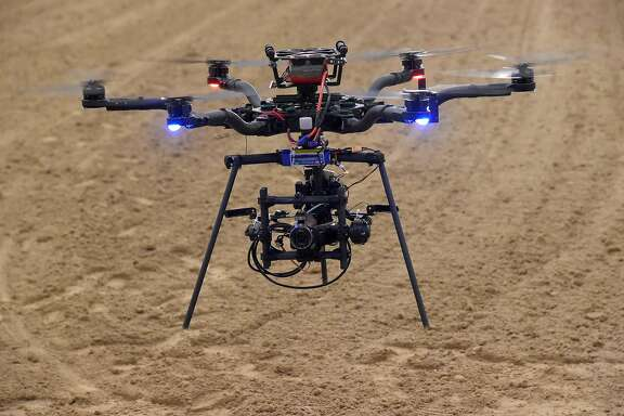 LAS VEGAS, NV - AUGUST 26: A Freefly Alta 6 drone is flown during an AviSight Drone Academy training class at the South Point Hotel & Casino on August 26, 2016 in Las Vegas, Nevada. The Federal Aviation Administration's new Part 107 regulations to operate small unmanned aircraft systems (sUAS) or drones, goes into effect on August 29, 2016. The new rules will allow operators of commercial drones weighing more than .55 pounds and less than 55 pounds to obtain a remote pilot certificate after passing a FAA knowledge exam. (Photo by Ethan Miller/Getty Images)