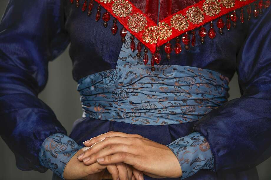 "A detail of Zanda Svede's (servant) costume in SF Opera's, ""Dream of the Red Chamber."" Photo: Russell Yip, The Chronicle"