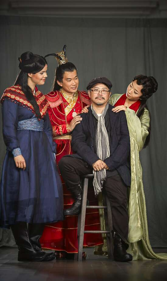 "The cast of SF Opera's world premiere, ""Dream of the Red Chamber,"" include Zanda Svede (servant, left), Yijie Shi (Bao Yu) and Pureum Jo (Dai Yu), who surround set and costume designer Tim Yip. Photo: Russell Yip, The Chronicle"