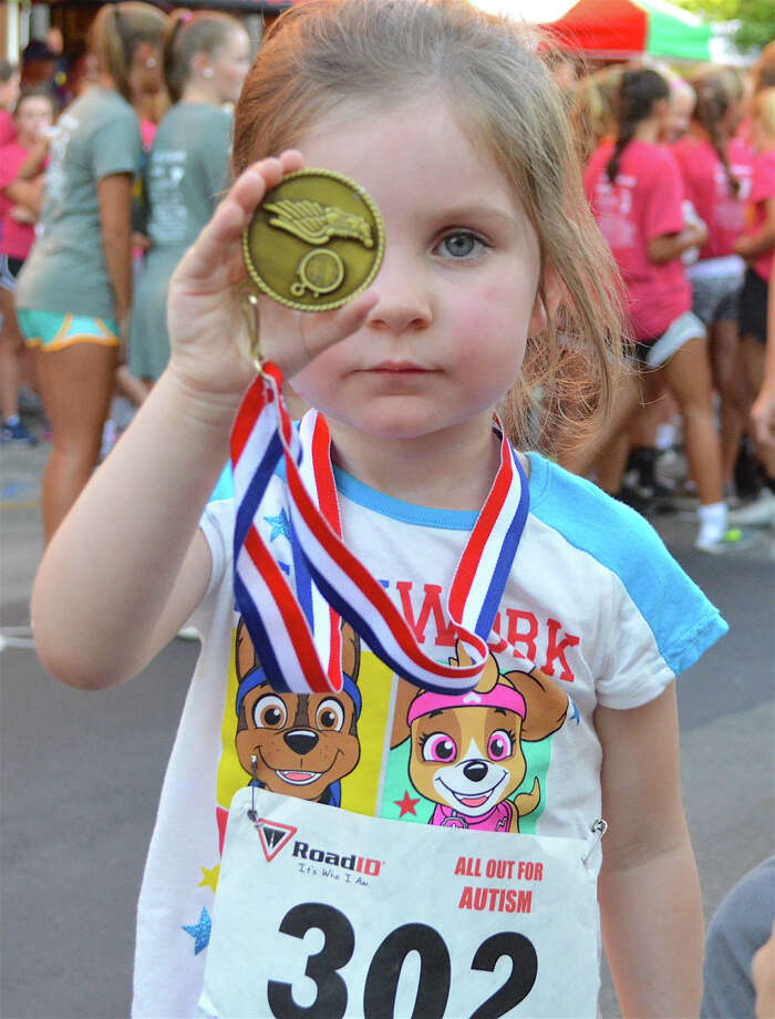 Catherine Smith, 3, of Rowayton, got the gold at the 8th annual All Out for Autisum 5k Walk & Run in New Canaan, Conn., Friday, Aug. 26, 2016. Photo: Jarret Liotta / For Hearst Connecticut Media / New Canaan News Freelance