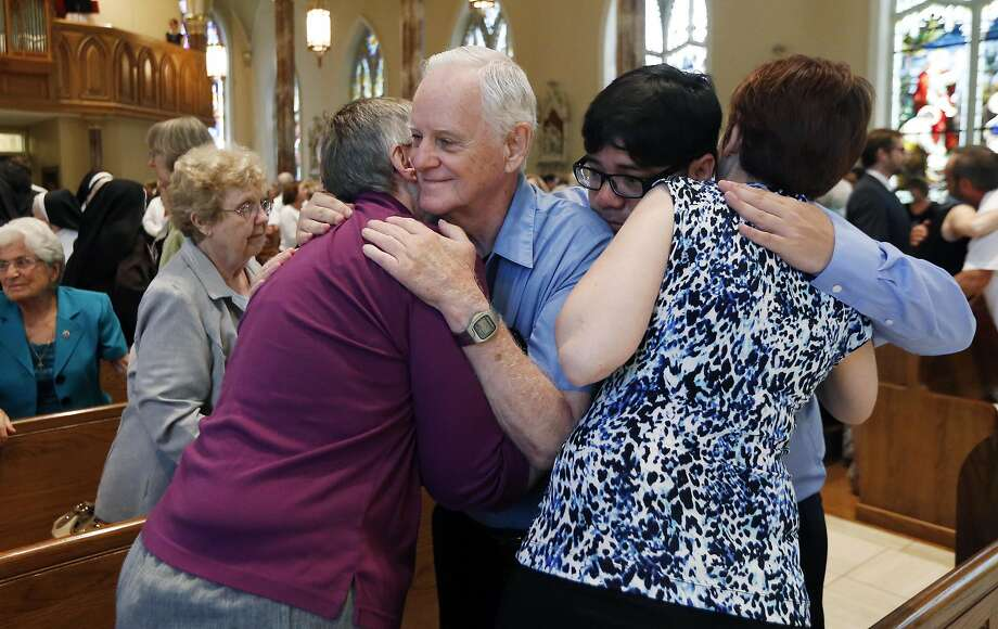 Family members of Sister Paula Merrill embrace during the service for Merrill and Sister Margaret Held at the Cathedral of St. Peter the Apostle in Jackson, Miss. Photo: Rogelio V. Solis, Associated Press