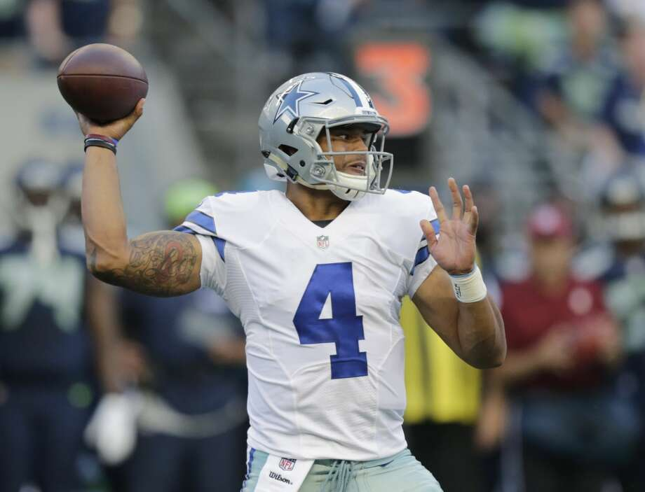 FILE - This Aug. 25, 2016 file photo shows Dallas Cowboys quarterback Dak Prescott passing against the Seattle Seahawks during the first half of a preseason NFL football game in Seattle. Prescott grew up rooting for the Dallas Cowboys in Louisiana and suddenly finds himself in line to start their opener as a rookie quarterback with Tony Romo sidelined by yet another back injury. (AP Photo/Stephen Brashear, file) Photo: Stephen Brashear/Associated Press