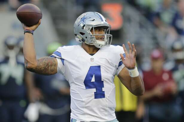 FILE - This Aug. 25, 2016 file photo shows Dallas Cowboys quarterback Dak Prescott passing against the Seattle Seahawks during the first half of a preseason NFL football game in Seattle. Prescott grew up rooting for the Dallas Cowboys in Louisiana and suddenly finds himself in line to start their opener as a rookie quarterback with Tony Romo sidelined by yet another back injury. (AP Photo/Stephen Brashear, file)