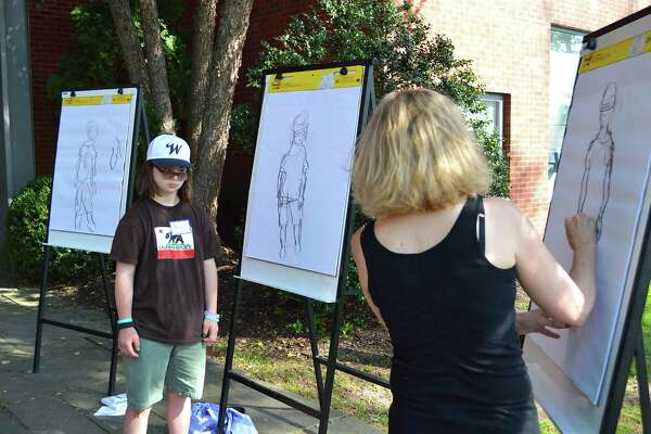 Elaine Clayton, right, does three different style sketches of Bella Rizzi, 14, of Westport, at the annual Sketching on the Saugatuck event at The Westport Library, Thursday, Aug. 25, 2016, in Westport, Conn.