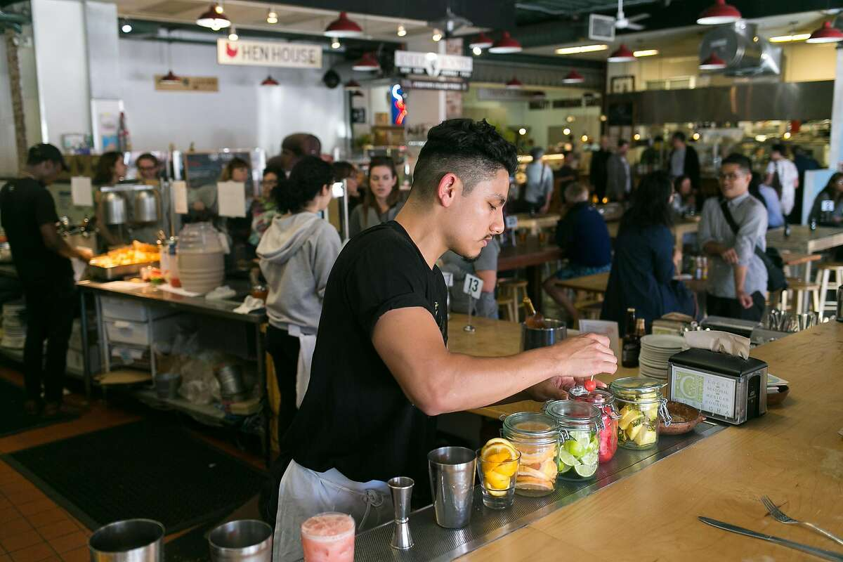 Bar manager, Tony Ortiz, garnishes a watermelon margarita at Cosecha inside of Swan's Market in Old Oakland.