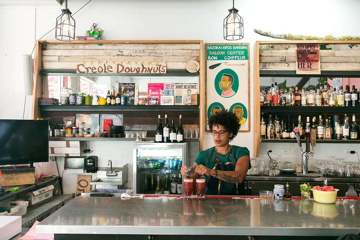 Rachel Satterfield makes cocktails at Miss Ollie's.