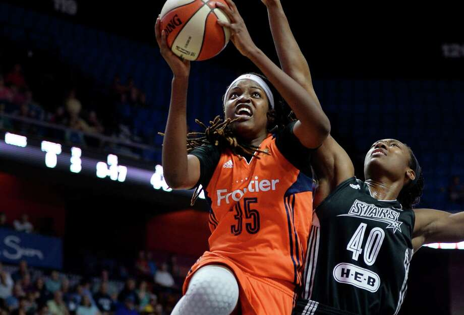 Connecticut Sun's Jonquel Jones (left) shoots against the Stars' Kayla Alexander during the first half on June 19, 2016, in Uncasville, Conn. Photo: Jessica Hill /Associated Press / AP2016