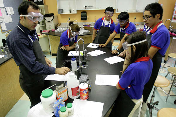 Chemistry teacher Murat Kaygusuz, left, conducts experiments with his class at Harmony Science Academy on Thursday, Sept. 24, 2009. JERRY LARA/glara@express-news.net