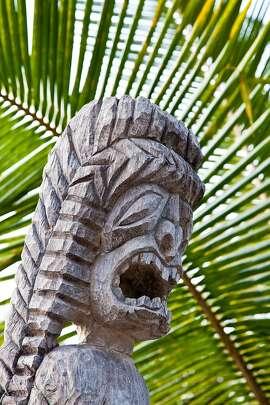 Carved  human figures known as kii (tiki) surround the sacred mausoleum at Puuhonua O Honaunau National Historical Park in South Kona.