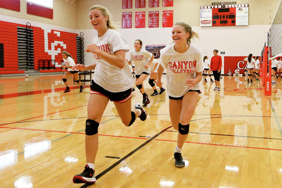 Skyler Clark (left) and Charli Fouts lead the way as New Braunfels Canyon Cougarettes run sprints on their first day of practice on Aug. 1, , 2016. Photo: Marvin Pfeiffer /San Antonio Express-News / Express-News 2016