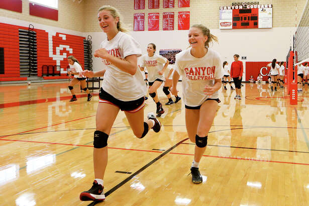 Skyler Clark (left) and Charli Fouts lead the way as New Braunfels Canyon Cougarettes run sprints on their first day of practice on Aug. 1, , 2016.