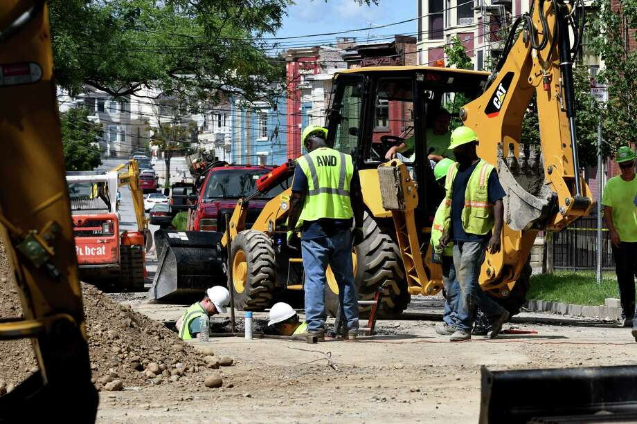 An Albany Water Department crew works on Elberon Place near the site of a sinkhole on South Lake Avenue on Monday, Aug, 29, 2016, in Albany, N.Y. (Will Waldron/Times Union) Photo: Will Waldron / 20037822A